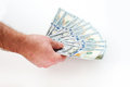 Hand of man holding fanned fistful dollars bills Royalty Free Stock Photo