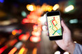Hand of man using map on smartphone application with bokeh.