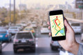 Hand of man using map on smartphone application with traffic jam