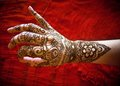 Hand with mehndi woman s mehendi at red textil background Stock Images