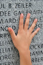 Hand on memorial Royalty Free Stock Photo