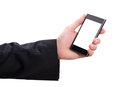 Hand and mobilephone closeup image of business man holding Stock Image