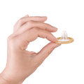 Hand with opeden yellow condom isolated white Royalty Free Stock Photo