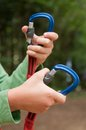 Hand opening carabiner mountain child that opens Stock Photography