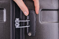 Hand opens suitcase combination lock Royalty Free Stock Photo