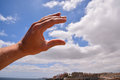 Hand over a Cloudy Sky Royalty Free Stock Photo