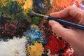 Hand and paint brush Stock Image