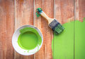 Hand paint brush and color bowl on wood board brush and bowl with gr green coating Stock Image