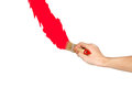 Hand with paintbrush red line painting. Isolated on white backgr Royalty Free Stock Photo