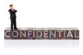Hand painted businessman figurine word confidential old metal letterpress isolated white background Stock Images