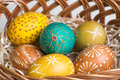 Hand painted easter eggs in brown basket Stock Photos