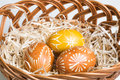 Hand painted easter eggs in brown basket Royalty Free Stock Images