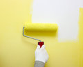 Hand painting white wall paint roller Stock Photography
