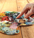 Hand with palette-knife and palette Royalty Free Stock Photography
