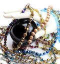 Hand with pearls, beads and crystal ball Royalty Free Stock Photo