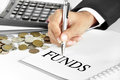 Hand with pen pointing to FUNDS word on the paper Royalty Free Stock Photo