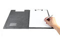 Hand with pen writing on clipboard white background clipping path Royalty Free Stock Images
