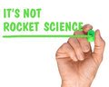 Hand with Pen Writing its not rocket science quote Royalty Free Stock Photo