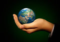 Hand of the person holds globe human holding a Royalty Free Stock Images