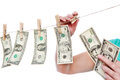 Hand pinch money on clothes line isolated Royalty Free Stock Photo