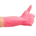 Hand in a pink domestic glove shows ok on white background Royalty Free Stock Photography