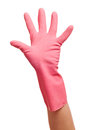 Hand in a pink domestic glove shows on white background Stock Photos