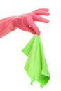Hand in a pink glove holding cloth green isolated over white background Stock Photo