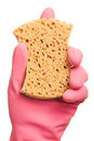 Hand in a pink glove holding sponge domestic Royalty Free Stock Photography