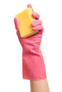 Hand in a pink glove holding sponge isolated over white background Stock Photos