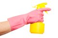 Hand in a pink glove holding spray bottle isolated over white background Stock Photo