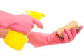 Hand in a pink glove holding spray and sponge bottle isolated over white background Royalty Free Stock Images