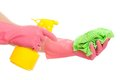Hand in a pink glove holding spray and sponge bottle isolated over white background Stock Photos