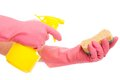 Hand in a pink glove holding spray and sponge bottle isolated over white background Royalty Free Stock Image