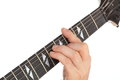 A hand is playing on a guitar fretboard Stock Photography