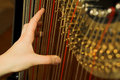 Hand playing harp Royalty Free Stock Photos