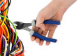 Hand with pliers and cable Royalty Free Stock Photo