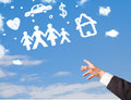 Hand pointing at family and household clouds with finger on blue sky Royalty Free Stock Images