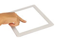 Hand pointing at modern tablet PC Stock Photography