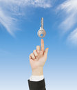 Hand pointing to key Royalty Free Stock Photo