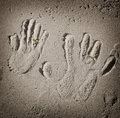 Hand print with golden ring two wedding rings on the sand Royalty Free Stock Images
