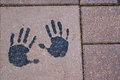 Hand print in stone paver Stock Images
