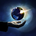 Hand protecting earth mens background Royalty Free Stock Photo