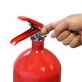 Hand pulling safety pin fire extinguisher Royalty Free Stock Photo