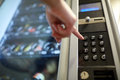 Hand pushing button on vending machine keyboard Royalty Free Stock Photo