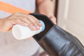 Hand put powder to a shoe odor stop close up Stock Photography