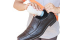 Hand put powder to a shoe odor stop close up Stock Images