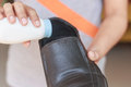 Hand put powder to a shoe odor stop close up Royalty Free Stock Image