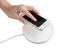 Hand putting mobile phone on wireless charger, modern equipment, Royalty Free Stock Photo