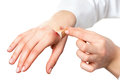 Hand putting plaster on hurt skin isolated Royalty Free Stock Photo