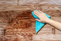 Hand with a rag to dust the wood furniture Royalty Free Stock Image